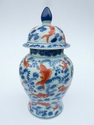 A FINE LARGE GINGER JAR AND COVER DECORATED IN BLUE AND OCHRE. 12.5  - 32cm HIGH • 13.50£