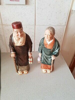 2 X Chinese Figures With Sticks And Packages Ceramics • 3.99£