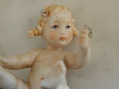 A Beautiful Naples Porcelain  Piano Baby Figurine • 1.60£