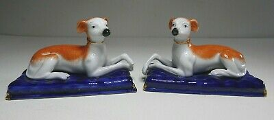 Pair Antique Staffordshire Ceramic Dogs Laying On Blue Ceramic Cushion Base  • 40£