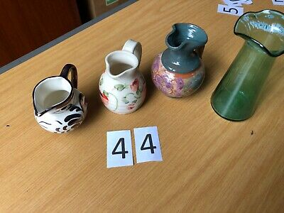 Three Jugs And A Glass Vase.   • 6£