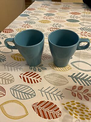 Two Turquoise Tea Cups • 1£