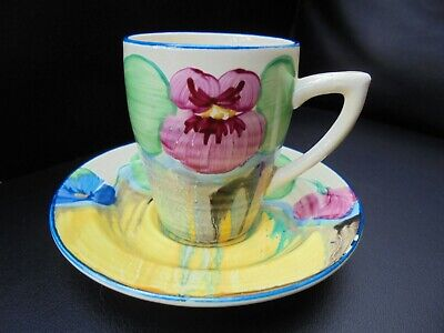 A Clarice Cliff Lynton Shape Coffee Cup & Saucer In DELICIA PANSY Pattern. • 270£