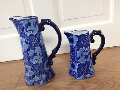Two Matching Elegant Blue Flower Decorated Pottery Jugs  • 10£