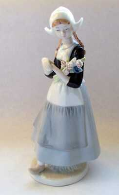 Dutch Girl Porcelain Figure With Flowers. • 20£