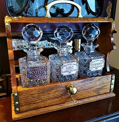 Antique Oak Tantalus With 3 Glass Decanters. • 251£