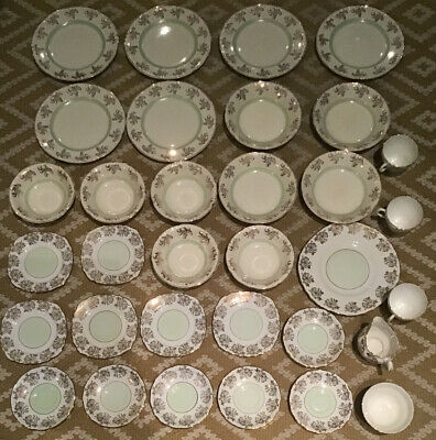 White, Gold And Green Bone China 33 Pieces • 35£
