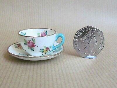CROWN STAFFORDSHIRE SCATTERED FLOWERS MINIATURE CUP AND SAUCER (Ref5526) • 17.50£