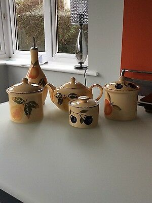 Teapot, Tea And Coffee Canisters, Sugar Bowl And Salad Dressing Bottle • 7£