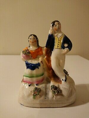 STAFFORDSHIRE Leaning Man And Sitting Lady With Flowers Ornament  • 20£