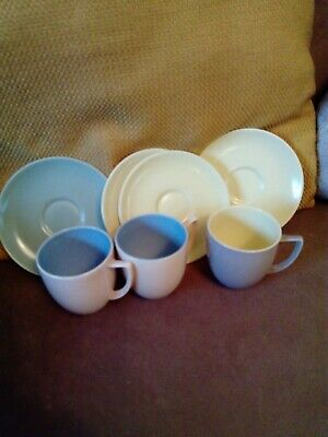 Branksome Two Tone Pottery Four Saucers And Three Cups.  • 4£