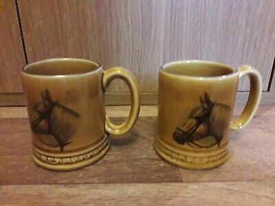 2 X MINIATURE TANKARDS, AMBER GLAZE WITH HORSE DESIGN. • 8.95£