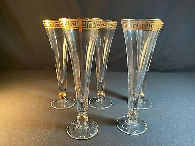 A Collection Of Five Champagne Flutes With Gold Accenting • 25£