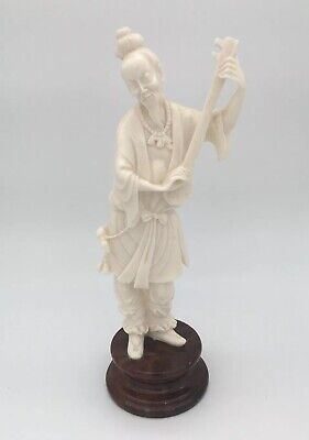 Oriental Chinese Figure Of A Man Holding A Musical Instrument • 32£