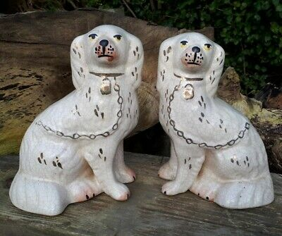 A Pair Of Large Victorian White & Gold Staffordshire Spaniel Dogs  • 125£