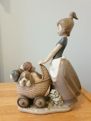 Lladro Figurine 'Litter Of Fun'.  Girl With Puppies In A Pram. • 100£