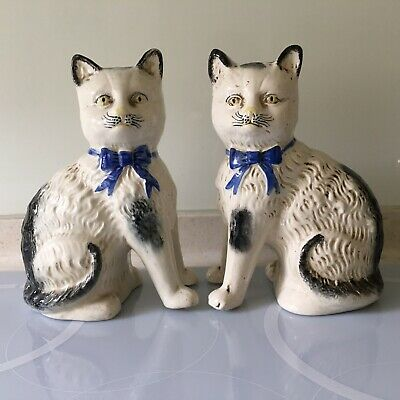 PAIR OF ANTIQUE STAFFORSHIRE POTTERY CATS WITH BLUE BOWS 20cm TALL • 55£