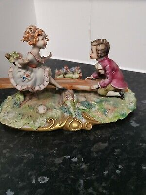 Capodimonte Figurine BOY And GIRL See Saw Playing  Signed AS SEEN PLEASE READ • 3£