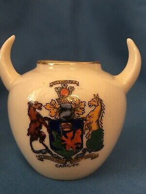 Crested China Round Pot With Bulls Horn Handles. Cardiff Crest • 4£