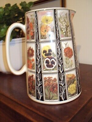 Ambergeldie Jug Decorated With Different Named Flowers. 9 X20  Circ. Multi Col. • 4.74£