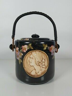 A Bretby Art Pottery Biscuit Barrel With A Relief Panel Of Lady's Head 15cm Tall • 178£