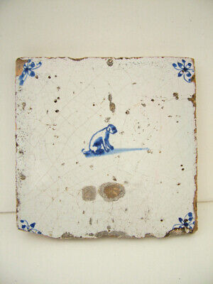 ANTIQUE 17th CENTURY  DUTCH DELFT  TILE  OF A SEATED DOG , SPIDER CORNERS. • 40£