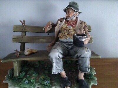 Capodimonte Figure. Tramp On Bench With Birds  Signed On The Base • 25£